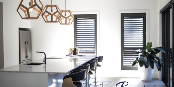Stained basswood shutters in dark brown for a kitchen