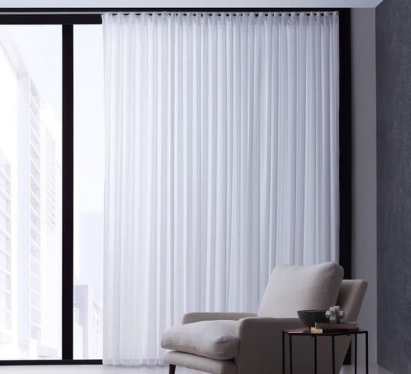 Sheer S-Fold Voile fabric in pure white in floor to ceiling window