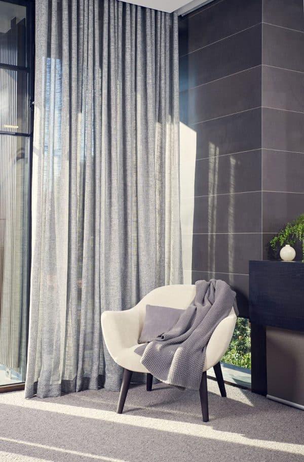 sheer light grey curtains in living room