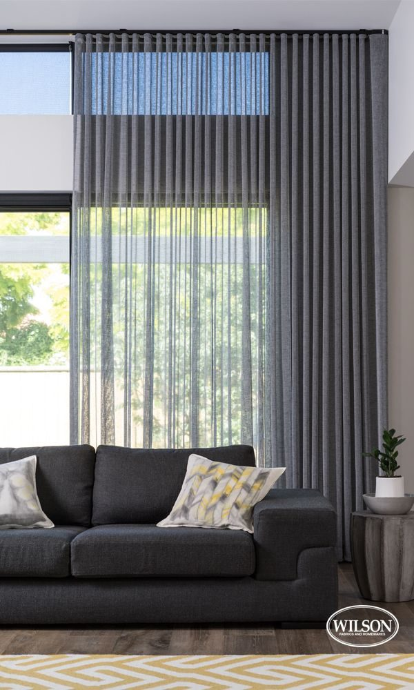 Mid grey sheer curtains in living room