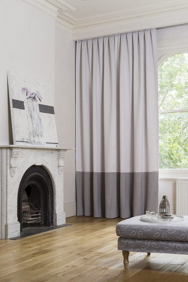 Dual Tone Blockout Curtains in a Room with Ornate Fireplace